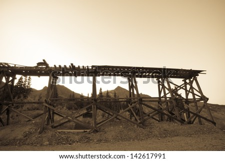 Red mountain and Yankee Girl Mine near Ouray, Colorado. - stock photo
