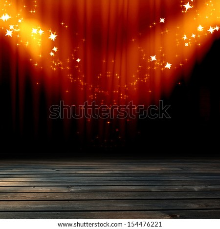 red movie or theater curtains with a spotlight on it - stock photo