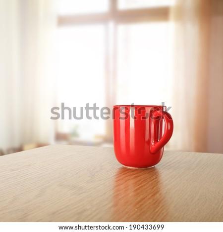red mug and window  - stock photo