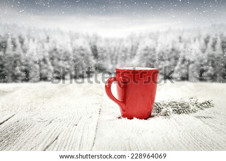 red mug of coffee and tree of green  - stock photo