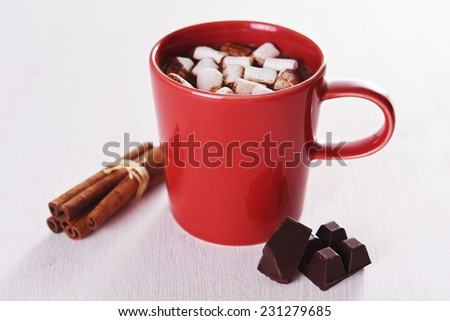 red mug with hot chocolate and marshmallow - stock photo