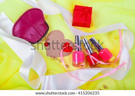 Red nail polish and female red purse - stock photo