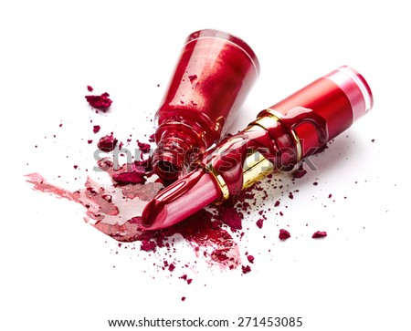 Red nail polish, crushed eye shadow and lipstick isolated on white background - stock photo