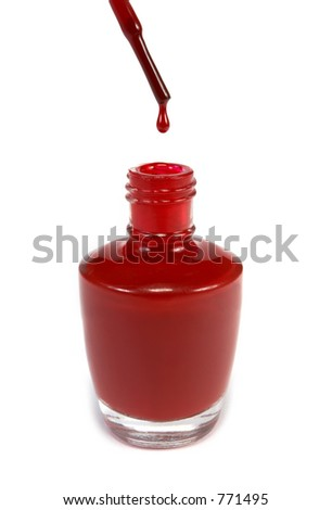 Red nail polish dripping off of brush - stock photo