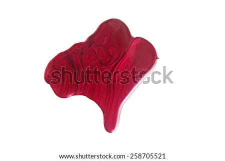 Red nail polish drops sample, isolated on white  - stock photo