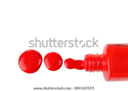 red nail Polish in the bottle and a little bit spilled on a white isolated background - stock photo