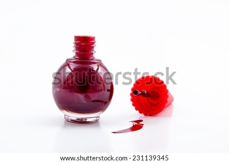 Red nail polish isolated on white background - stock photo