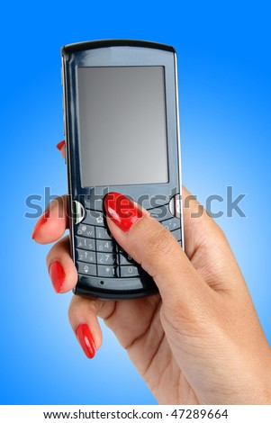 red nail polish on a female hand with a smart phone