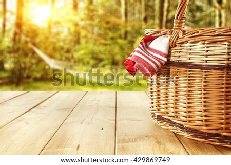 red napkin basket and yellow table  - stock photo