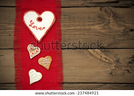 Red Natural Fabric Place Mat As Texture With Copy Space On Wooden Background With Country Style And Four Heart Cookies With Love
