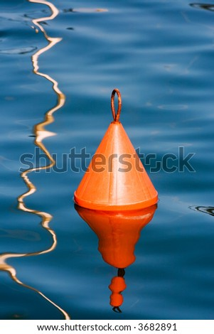 Red Navigation Buoys are placed on the Mediterranean Coast to mark shallow spots in the sea. These are big, heavy steel objects anchored by cable to huge concrete blocks on the seabed - stock photo
