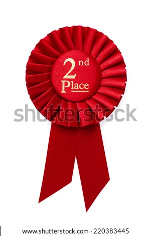 Red 2nd place ribbon rosette with gold central text in a pleated surround isolated on white - stock photo