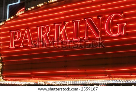 Red neon parking sign - stock photo