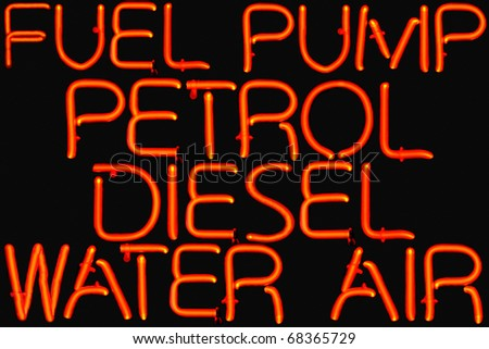 Red neon sign of petrol station services.