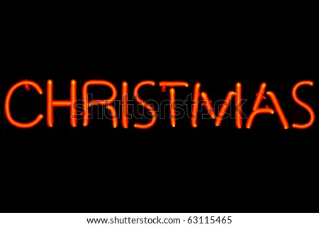 Red neon sign of the words 'Christmas' on a black background. - stock photo