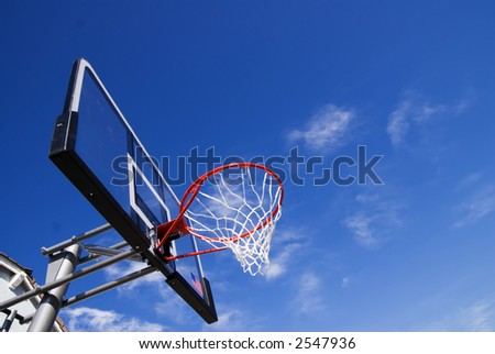 Red New Basket Ball Net Under Beautiful Blue Sky - stock photo