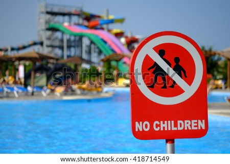 Red no children warning sign at the poolside - stock photo