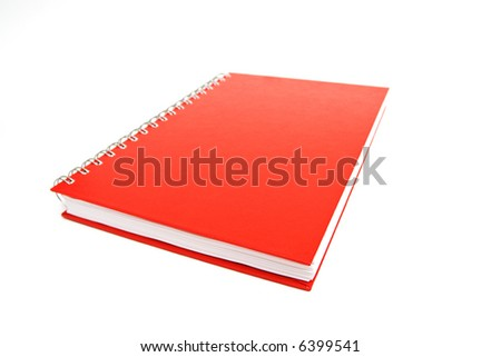 Red notebook isolated on white. Shallow DOF. - stock photo
