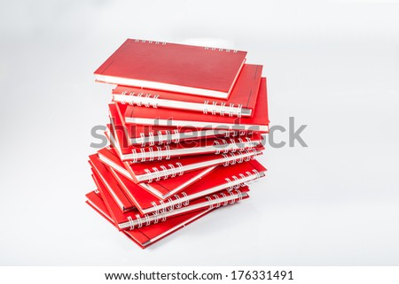Red notebooks isolated on white - stock photo