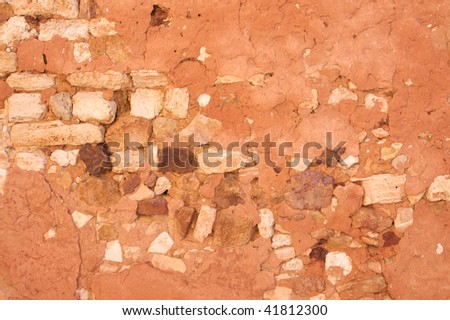 Red Ochre Stone Wall Background - stock photo