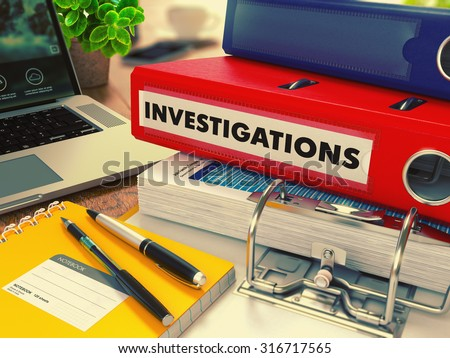 Red Office Folder with Inscription Investigations on Office Desktop with Office Supplies and Modern Laptop. Business Concept on Blurred Background. Toned Image. - stock photo