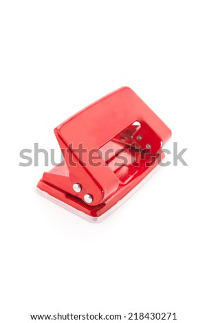 Red office punch isolated on white background