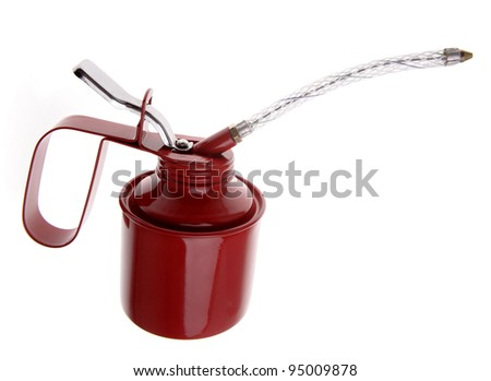Red oil can on plain background