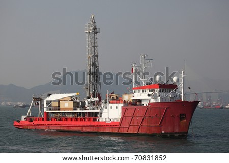 Red oil drilling ship in harbor