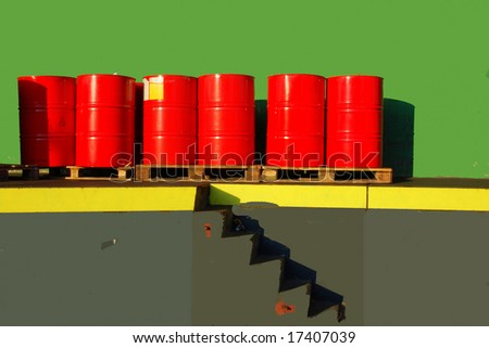 Red oil drums on a shipping ramp - stock photo
