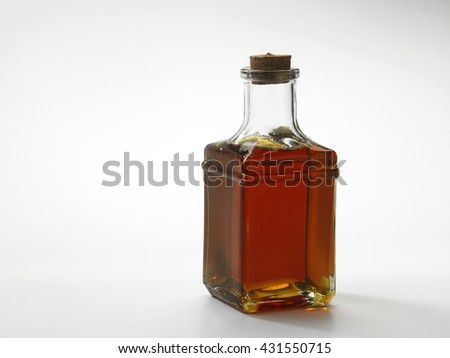 red oil palm oil in a bottle - stock photo