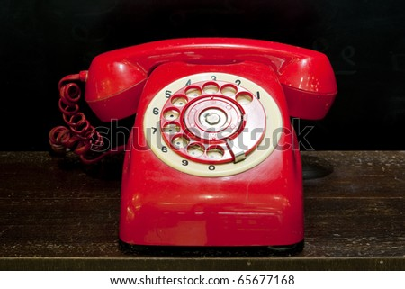 red old bt telephone on black background - stock photo