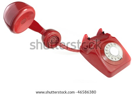 Red old fashioned style telephone from 1970's - stock photo