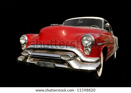 Red old muscle car isolated on black backgound - stock photo