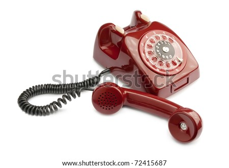 Red old phone isolated on white background