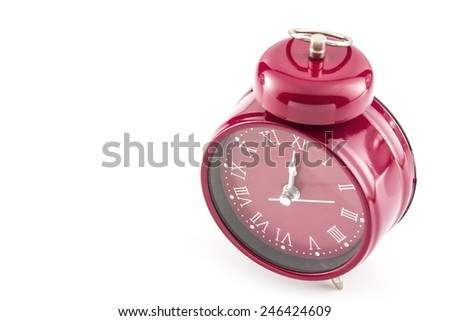 red old style alarm clock isolated on white - stock photo