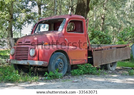 Red old timer truck in the forest