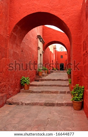 red old traditional building with arch - stock photo