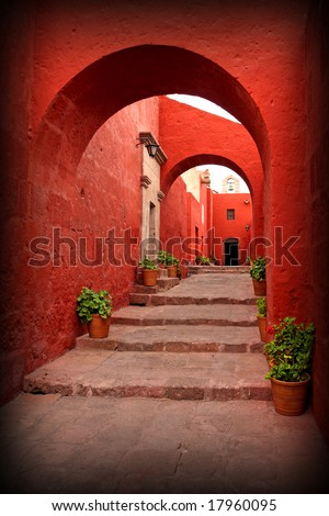 red old traditional building with arch