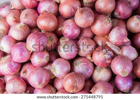 Red onion bulb for sale at market,Thailand - stock photo