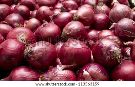 Red onions in plenty - stock photo
