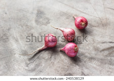 Red onions on wooden background - stock photo