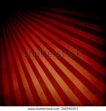 red orange background retro striped layout with dramatic black border, sunburst abstract background texture pattern, vintage background sunrise design, nostalgic retro design  - stock photo