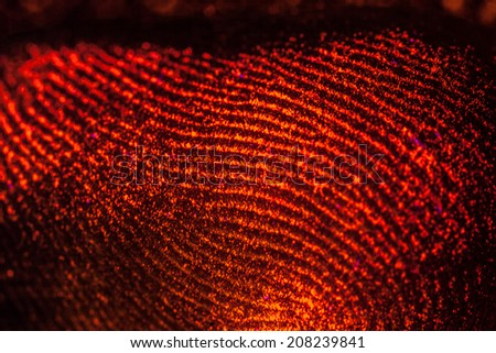 red-orange fingerprints on black - stock photo