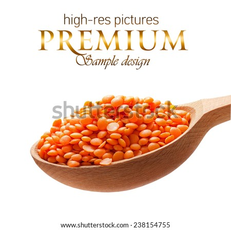 Red-orange lentil in a wooden spoon / beans on wooden spoon isolated on white background with place for your text  - stock photo