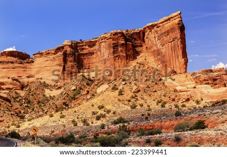Red Orange Tower of Babel Rock Formation Canyon Arches National Park Moab Utah USA Southwest. - stock photo