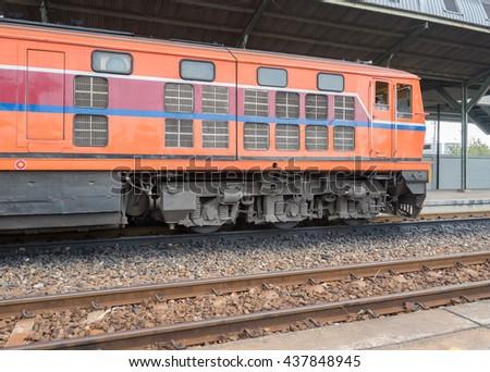 Red orange train, Diesel locomotive, on railway station  - stock photo