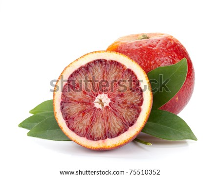 Red oranges with leafs. Isolated on white background