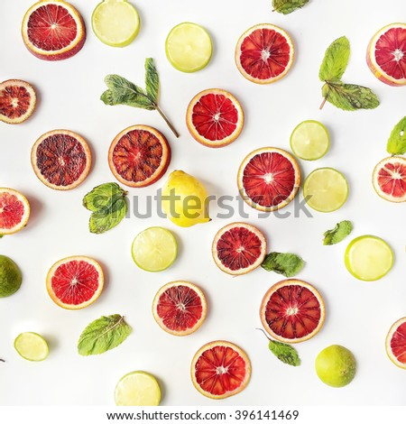 Red oranges, yellow lemons, green limes and mint pattern isolated on white. Flat lay, top view - stock photo