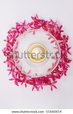 red orchid circle with bowl and candle top view