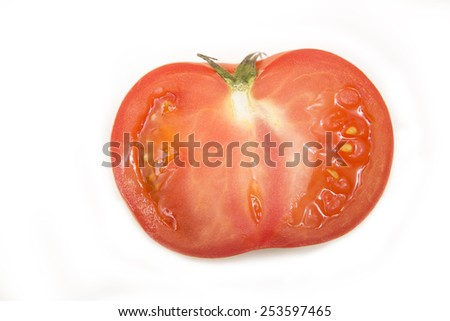 red organic tomato slices on white background